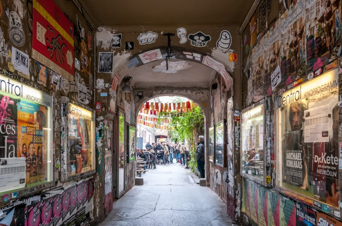 Hallway to backyard with independent movie theatre, restaurants and artsy shops