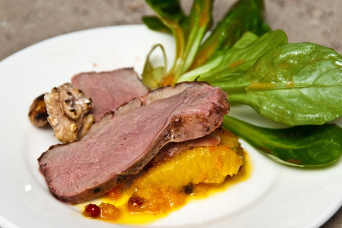 Rosted duck breast on peppered oranges ready to be served