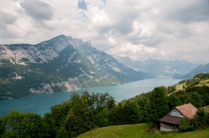 Riding through the Swiss Alps and stopping at lake Walensee.