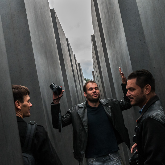 Lee discussing with Tobias and Igor about history at the Jewish memorial.