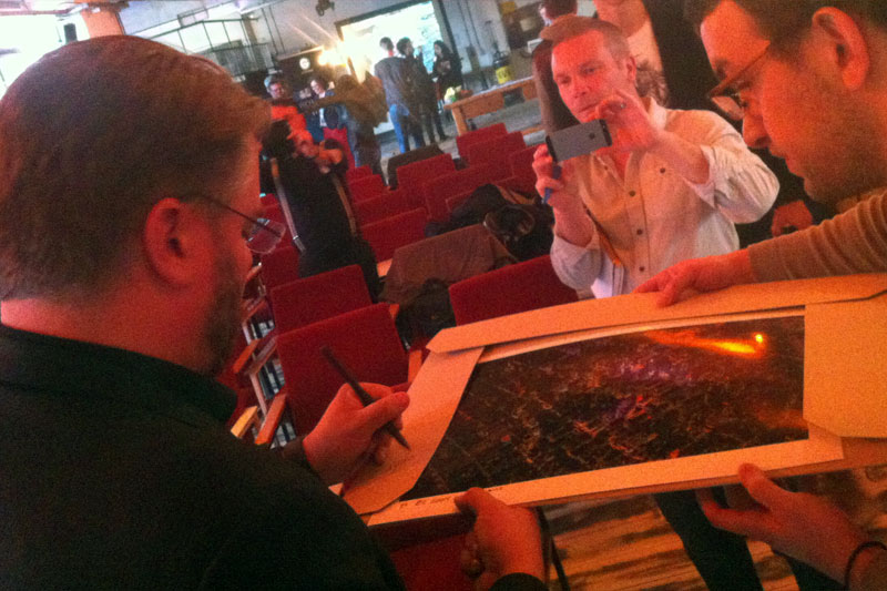 iPhone snapshot: Vincent Laforet signing a lithograph of his Laforet Air series for a lucky winner.